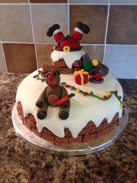 Santa stuck down the chimney with reindeer xmas cake Santa stuck in chimney cake