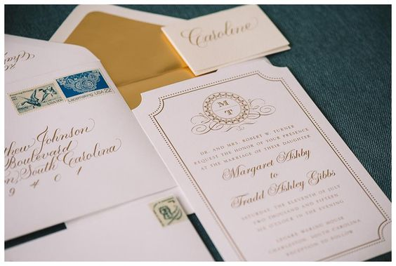 Wedding invitation suite with monogram detailing by Wedding Paper Divas, calligraphy by Penned by Palmer. Image by Jennings King Photography.