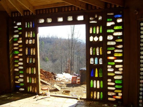Earthbag Building: A bottle wall made from old wine and liquor bottles. Pretty.