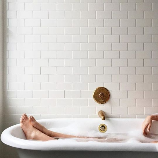 clawfoot tub and tile: