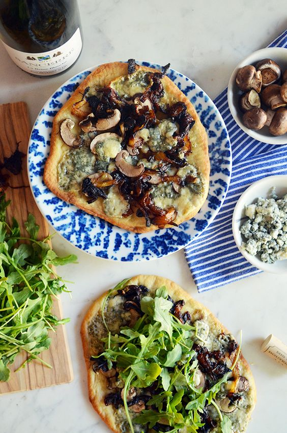 This Mushroom Flatbread recipe is a fun way to use the grill and keep your guests full and happy this summer!