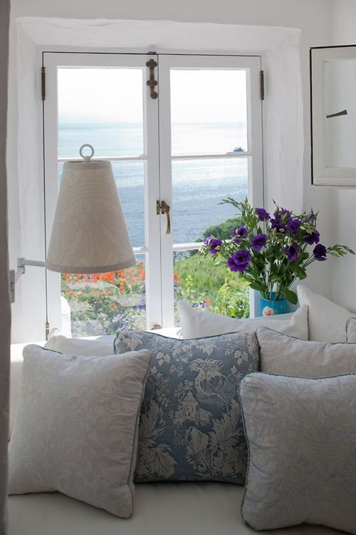 cozy corner...just perfect to contemplate or mull over something snuggled up on those cushions on the sofa looking out to that view