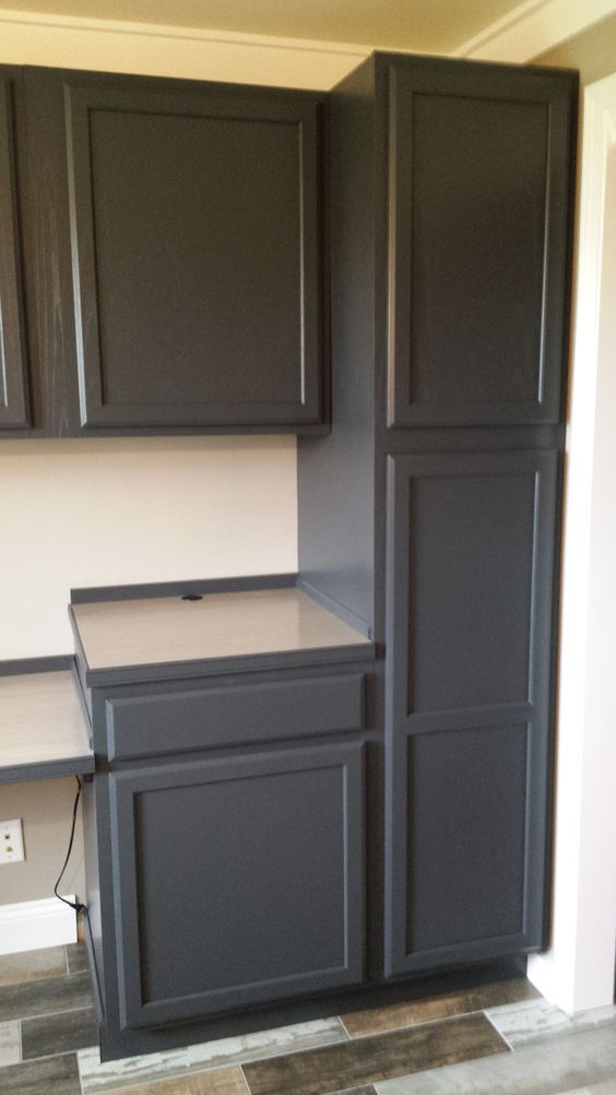Finished cabinets painted in behr cracked pepper office for Behr paint for kitchen cabinets