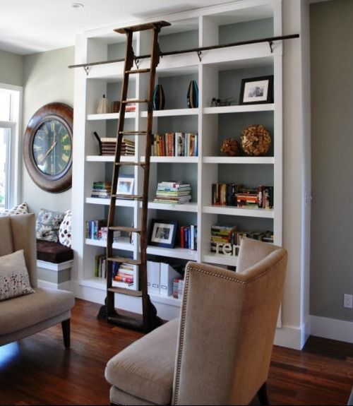 Good color scheme. Medium wood tones and grey/blue walls with tan. Like.