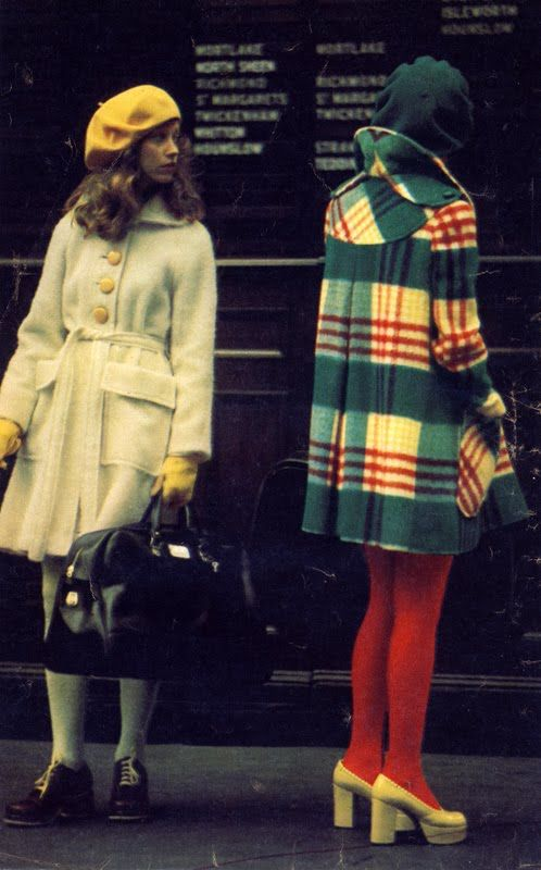 Winter wear at Waterloo Station, 'Petticoat' magazine, October 1971. White coat by Alexander Newman, plaid coat by Electric Fittings. Photo by Roger Charity.
