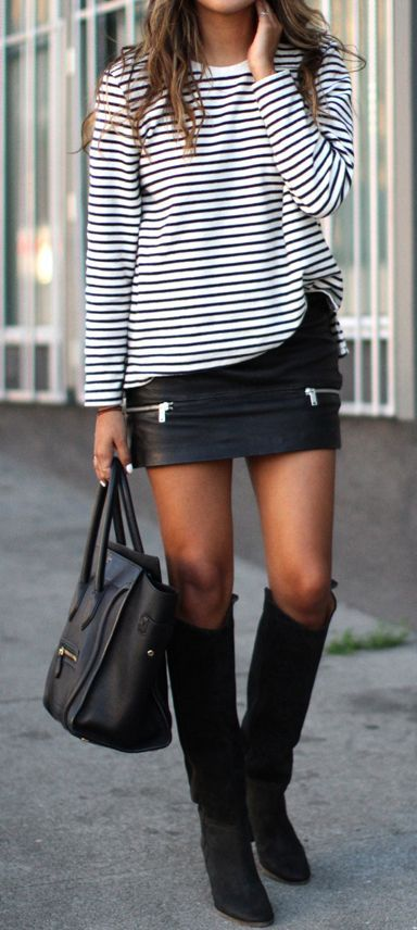 striped sweater and leather skirt with tall boots: