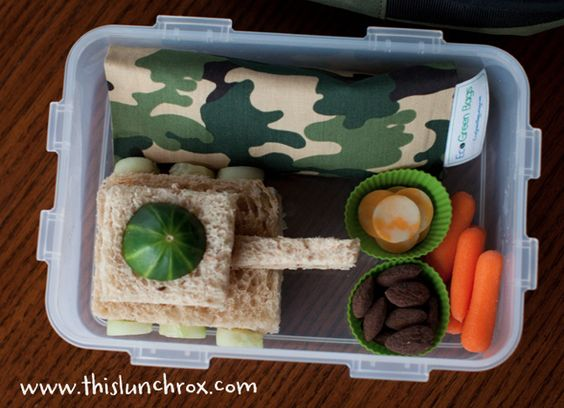 Healthy Lunch Boxes for Kids  Today's Army tank lunch includes:  turkey/cheese tank sandwich with cucumber wheels and top, chocolate almonds, colby cheese, carrots, almond flour/chocolate chip  mini cookies (in the green camo bag):