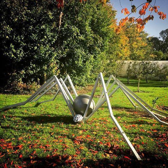 Yoga ball, bike helmet and recycled metal light fixtures. #giantspider #spider #recycle #recycleart #halloween #halloweendecorations #autumn #nature #creepycrawly #eveestuary #rachelkiernan #artclass