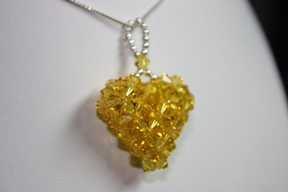 I think these would be awesome for the bridal party.   Woven Swarovski Heart Pendant by CreationsWithColor on Etsy, $17.00