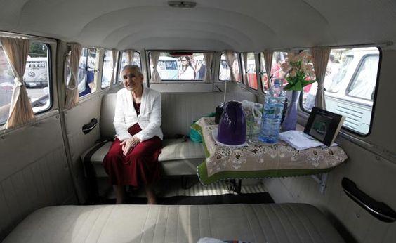Marcilia Coelho, 87, sits inside a Volkswagen Kombi during a Kombi fan club meeting in Sao Bernardo do Campo December 8, 2013.