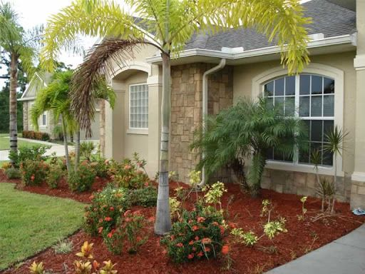 Photos entrance and mobile homes on pinterest for Landscaping around house