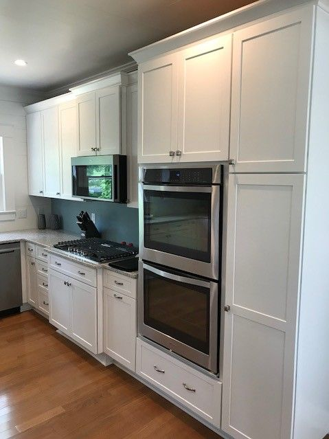 This Beautiful White Farmhouse Kitchen Was Designed With Simplicity In Mind Clean Lines Whi Installing Kitchen Cabinets Kitchen Installation Kitchen Decor