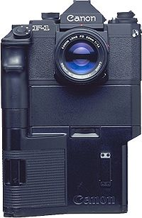New F-1 High Speed Motor Drive Camera - Fer 1984 (Based on the New F-1 and equipped with a fixed pellicle mirror, this camera boasted the fastest continuous shooting speed ever. It has a four-axis, horizontal-travel, focal-plane electromagnetic shutter with metal curtains. One of three shooting speeds can be set. At the H setting, the camera can zip through a 36-exposure roll of film in 2.57 sec. at 14 fps.)