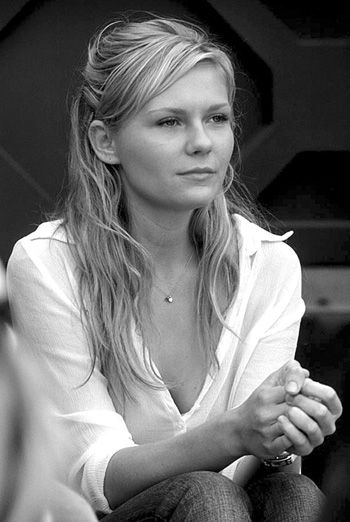 Kirsten Dunst...my mom looked just like this when she was younger...it's really frightening!!
