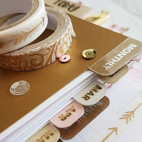 A bit of a close up so you can see the dividers I made. I used my #silhouettecameo to cut out the cardstock and then my #minc to create foiled stickers for the edges. Not only do they look fantastic but they provide extra support when flipping sections. #planner #kikkik #kikkikplannerlove #planneraddict #plannergirl #plannerlove #sequins #washi #washitape #minc #goldfoil #silverfoil #officeworks #silhouettecameo #michaels #papertreyink