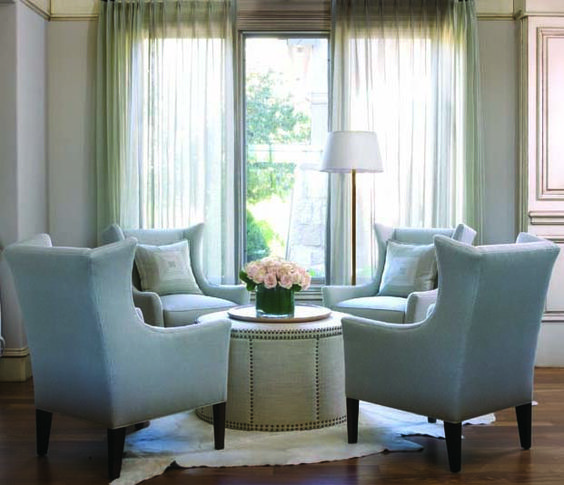 Like the look of the circular table with 4 surrounding chairs. Works very well in a rectangular room to break it up.