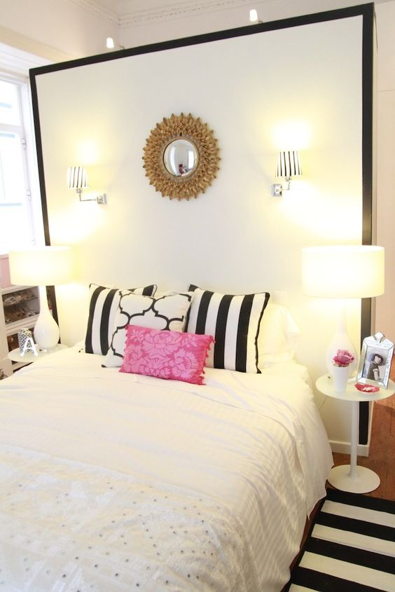 black & white & pink bedroom - gold sunburst mirror, pillow