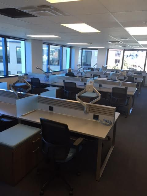 CASA of Tarrant (Fort Wort, TX) WaveWorks worksurface and storage with Epicenter and Mix-it seating in open plan space.  #NationalOffice