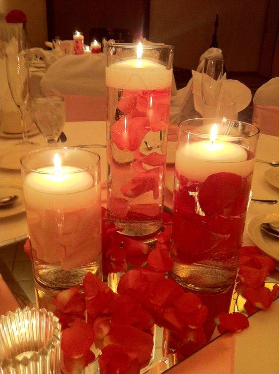 Floating rose petal centerpiece cylinder centerpieces
