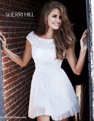This Romantic and Flirty #SherriHill has a #High-neckline and is available in other colors