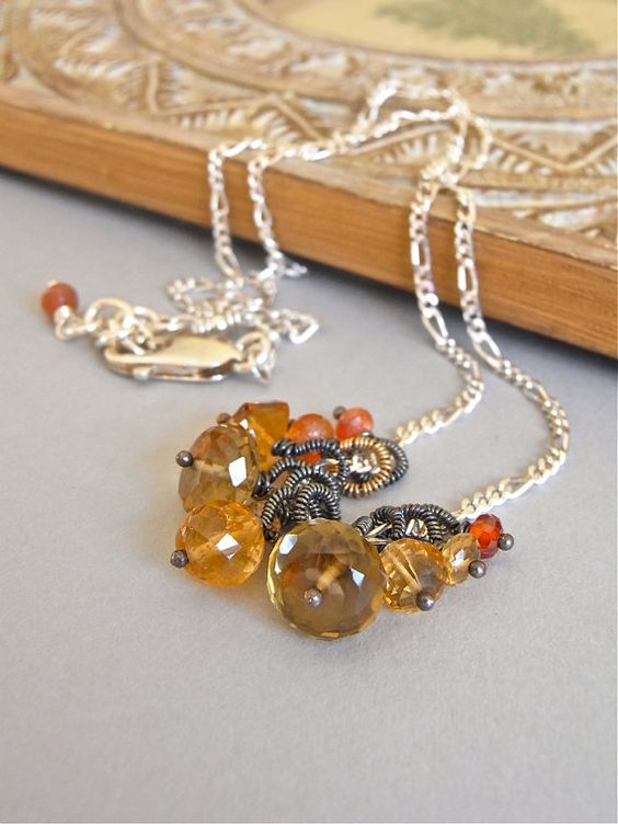 The Honeycomb necklace - mixed gemstones have been carefully wirewrapped and suspended from a bright sterling chain.  Very dainty, in lovely warm hues.