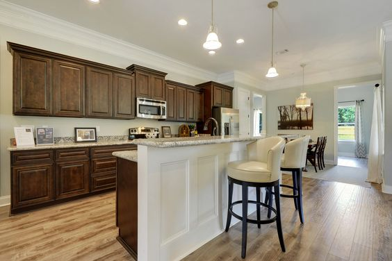 Large Galley Kitchen With Chocolate Cabinets And