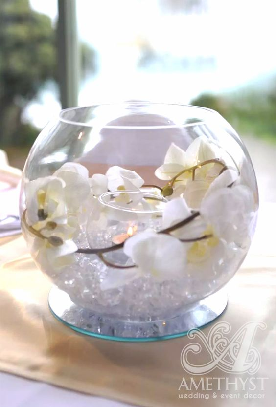 Beautiful wedding fishbowl centerpiece with white orchids for Fish bowl centerpieces ideas