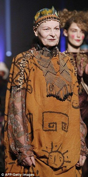 FRANCE, Paris : British fashion designer Vivienne Westwood (c) acknowledges the public at the end of her 2014/2015 Autumn/Winter ready-to-wear collection fashion show, on March 1, 2014 in Paris. AFP PHOTO / PATRICK KOVARIK