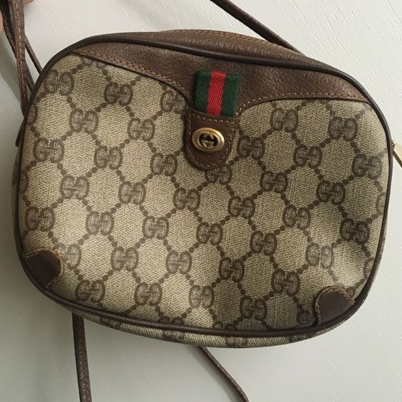 """Classic rareGUCCI Vintage shoulder/  Crossbody Read full description: Vintage small Gucci bag can be worn as a Crossbody or shoulder bag. Refer to measurements. bag height about 5.5"""" bag depth about 1.6 """" length about 7.1"""" and strap drop is about 21"""" . It is vintage condition and photos depict that as best as possible.    Please note inside of bag is blowing out dust because the bag lining is flaking. bag age estimate from 70's or 80's Gucci Bags Shoulder Bags"""