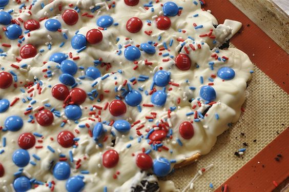 patriotic bark (crushes oreos and pretzels topped w/ melted white chocolate, star spangled m and jimmies)