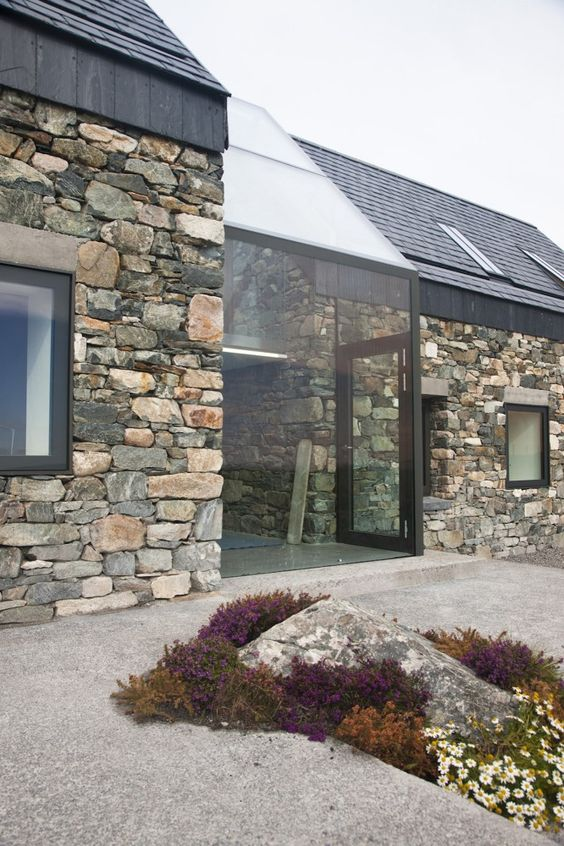 Connemara / Peter Legge Associates   Connemara in Co Galway, Ireland has many wonderful examples of the juxtapostion of old with new, or like this with a respect for the tradtional venacular with use of the natural local stone in a studding contemporary house which sits well in the countrysde.  R McN: