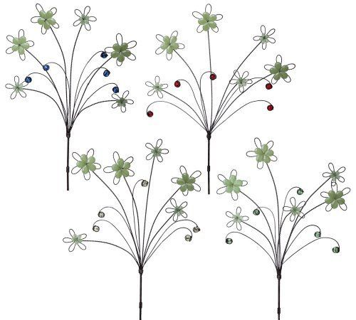 """Glow in the Dark Garden Stake by Outdoor Decor. $13.49. Stakes made of metal and plastic.. 12"""" L x 0.75"""" W x 37"""" H. Glow in the Dark.. Great for yourself or as a gift!. From the Garden Stake Collection.. These garden stakes are perfect for your yard or garden. With its tree or bush-like design, these garden stakes will fit right into your garden landscape. And at night, these garden stakes will light up, illuminating themselves as well as the nearby flowers and shrubbery."""