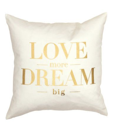 Cushion cover in cotton twill with gold-colored, printed text. Concealed zip.: