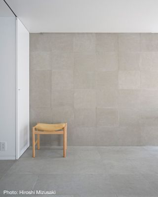 Tiles from floor to wall