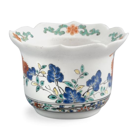 A CHANTILLY SMALL BOWL CIRCA 1735 with a shaped everted rim, painted in the Kakiemonstyle with flowering plants, a border of stylised flowering branches around the footrim