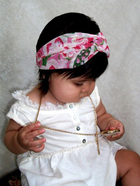 I know the gal who makes these, and have had the pleasure of playing with the sweet girl who is modeling the headband.  Pink and Green Paisley HeadwrapTurban Infant Headband by LillyWest, $16.00