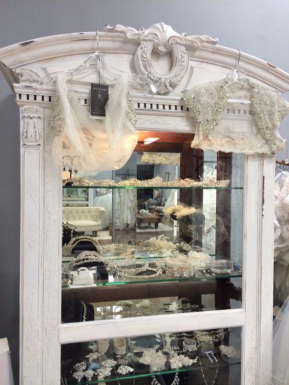 DIY antiqued armoir for bridal store.