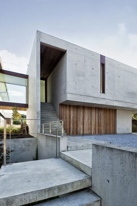 The wood and cement feel for this modern home extension