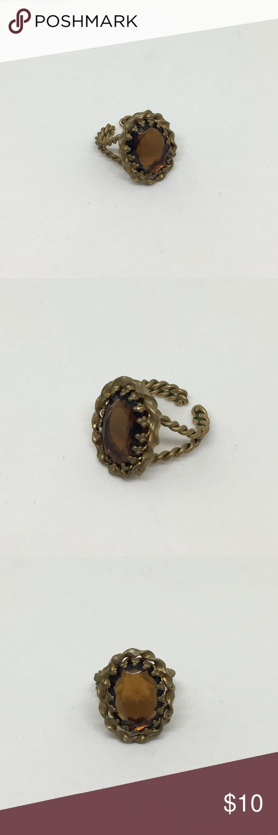"""🆕Vintage Antique Gold Brown Faceted Ring An adjustable ring made of braided antique gold, with a faceted glass """"stone"""" in a deep brown. Adjustable from size 5 up. In excellent vintage condition. Vintage Jewelry Rings"""