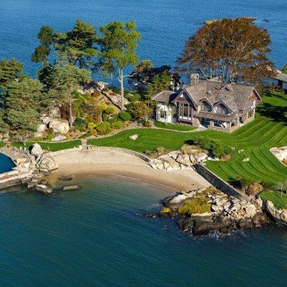 This island home is right off the coast of Connecticut. Its owners commute to New York by boat