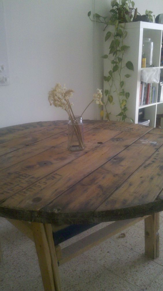 A table I made using a wooden spool. It's 80cm tall with a diameter of about 2m. Unfortunately I made this before I discovered screws so it's nailed together and very wobbly.