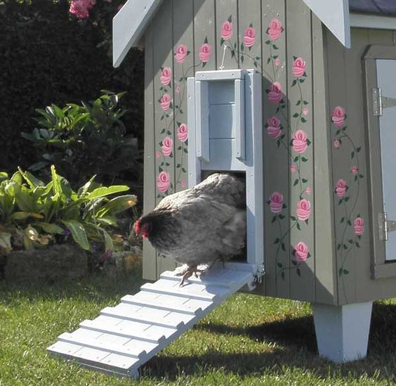 The Fantasia Rose Painted Hen House is decorated with hand-painted roses, making it a truly one-of-a-kind piece of art.