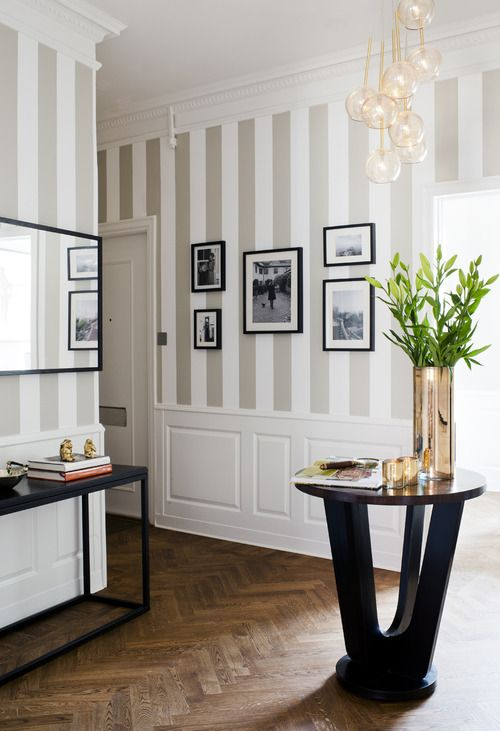You can't beat stripes for elegance - taupe or dark beige and ivory help create an atmosphere of unadulterated style, particularly when teamed with pale panelling, parquet flooring and well designed and proportioned pieces of furniture. This is a beautiful hallway that exudes charm and sophistication yet is welcoming and bright.: