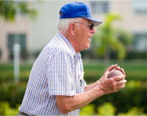 senior readies a throw at softball