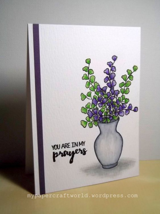 The shadow at the bottom of the vase anchors the whole card.