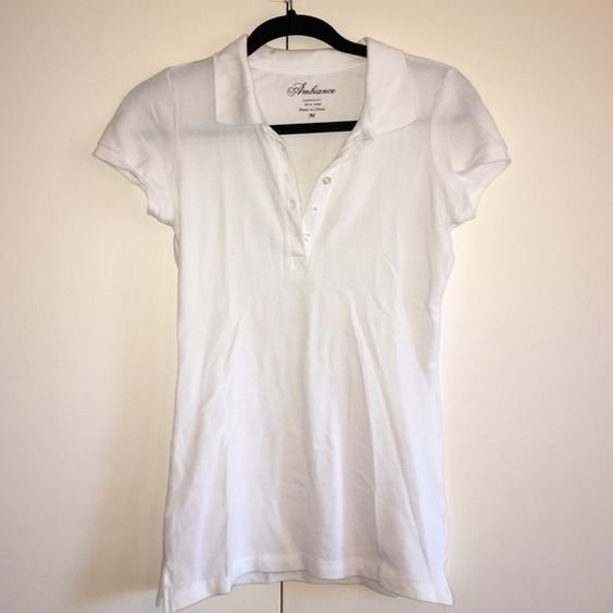 White button up collared top, Riverland, size M This white collared button up top is a size Medium but can fit a small as well. Purchased from Riverland the same day as the previous listing (same shirt in black but a size smaller) and worn only once. Wrinkles can easily be removed after a wash and hang dry. Feel free to leave any comments/questions/offers<3 Riverland Tops Button Down Shirts