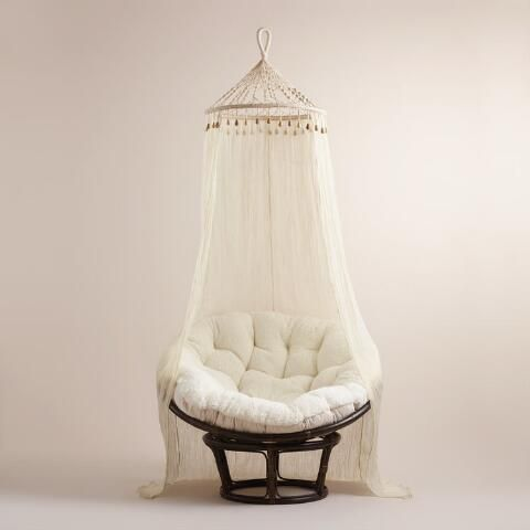Crafted in India of sheer 100% cotton, our exclusive canopy features a macrame netting top with wood bead accents for added bohemian-chic flair. This gauzy accent looks incomparably romantic when draped over a bed, surrounding a papasan chair or even shie