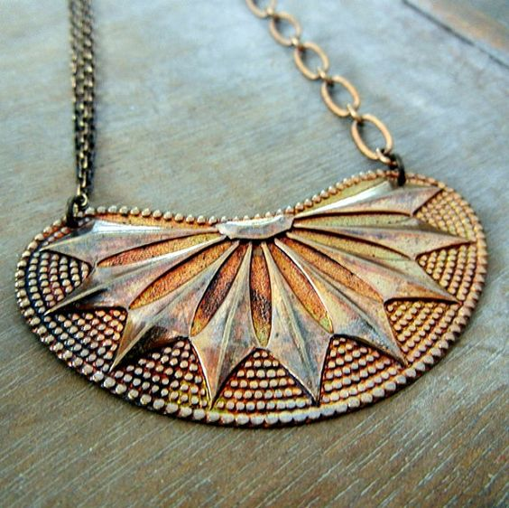 Hey, I found this really awesome Etsy listing at http://www.etsy.com/listing/125205046/native-sun-vintage-style-antiqued-brass