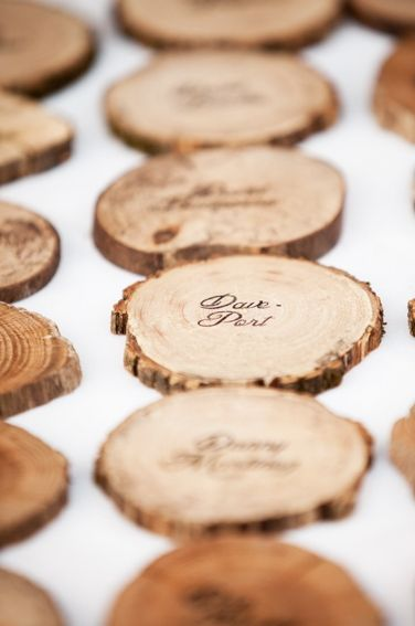 "cute idea for escort ""cards"" for a rustic wedding. --What would also be a cute idea is to have a stack of four or so wrapped together for favors(rustic coasters) with guests name on a tag. Just make sure they are treated/sealed properly, and bam, you're killing to birds with one stone!:"