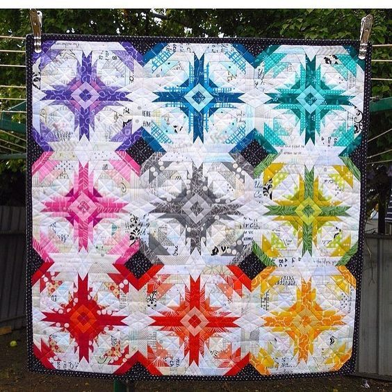 According to the photographer... this is an off center pineapple block. I think it would require a good deal of preparation and pre-planning to get all the colors in the right place. But so worth it!